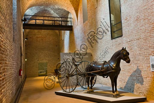 Piacenza, Farnese Palace, Municipal Museums, the Carriage Museum : sulky and horse statue.