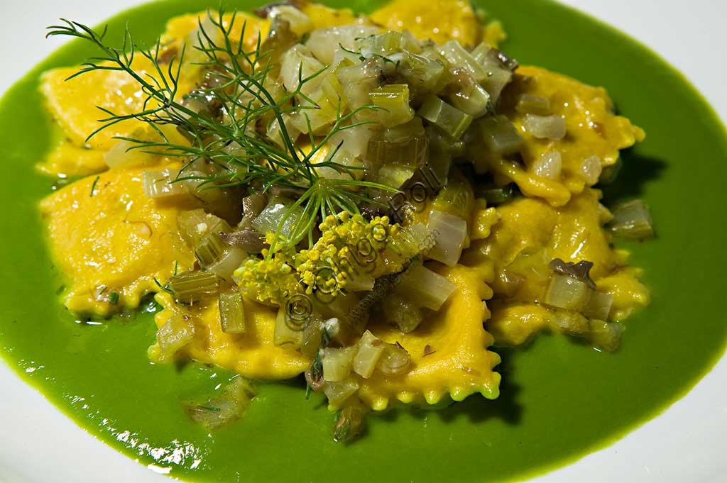"A plate of vegetarian ""ravioli"" (kind of typical Italian first course) seasoned with celery and other vegetables."