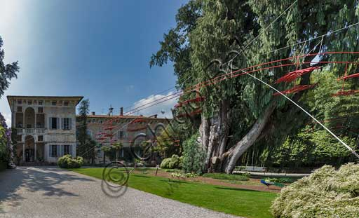 """Isola Madre, the Borromeo Palace: the loggia, the Kashmir cypress and """"Playtime"""", artwork by Velasco Vitali."""