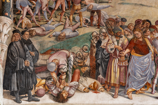 """Orvieto,  Basilica Cathedral of Santa Maria Assunta (or Duomo), the interior, Chapel Nova or St. Brizio Chapel, lunette of the west wall: """"Preaching and the facts of the Antichrist"""", fresco by Luca Signorelli, (1500 - 1502). The men dressed in black on the left hand side of the wall are the portratis of Luca Signorelli and Beato Angelico. Detail."""