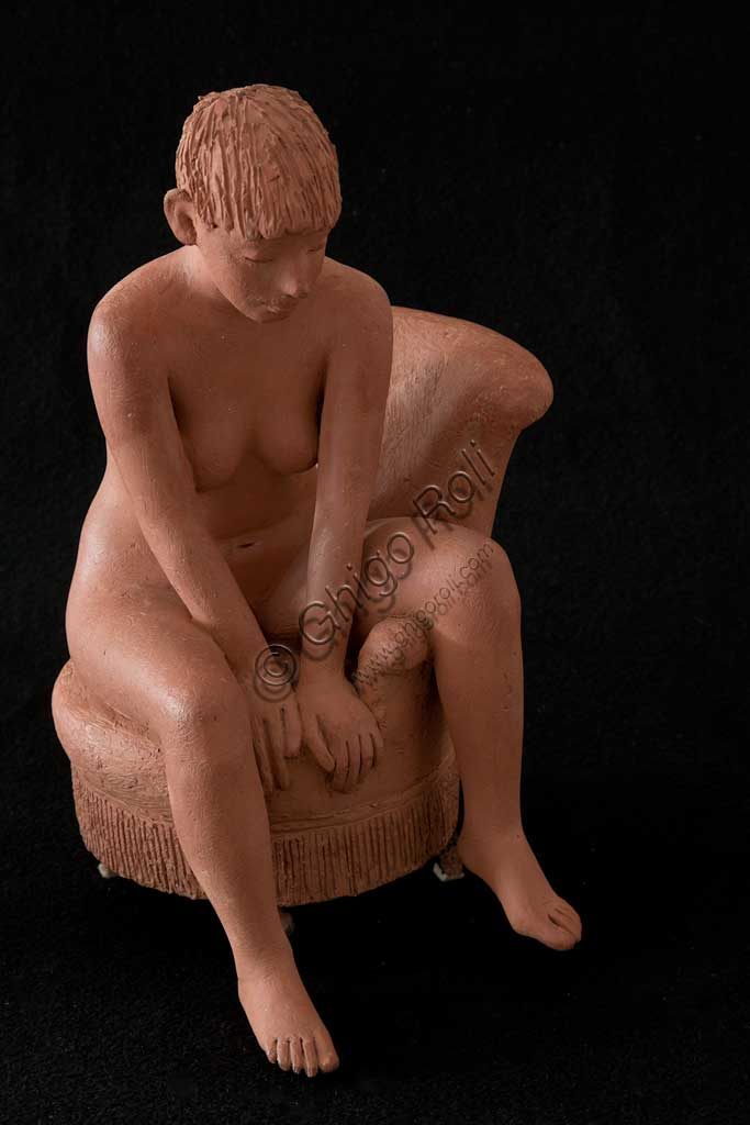 "Assicoop - Unipol Collection:  Vittorio Magelli  (1911-1988); ""Girl sitting on an Armchair""; Earthenware sculpture; h. cm. 125."
