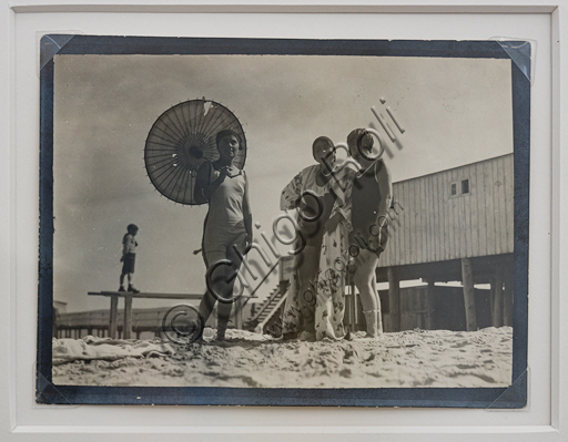 """""""Girls at the seaside, one holding a parasol"""", bromide silver gelatine by Marcello Dudovich,  1930-40."""