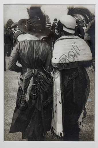 """""""Girls from the back wearing a feathered hat"""", bromide silver gelatine by Marcello Dudovich,  1910."""