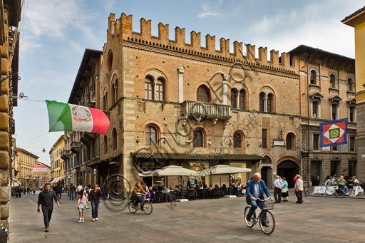 Reggio Emilia, old town centre: the Posta Hotel on the corner between Del Monte Square and Emilia San Pietro road. People riding a bike.