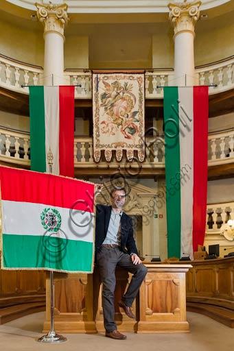 Reggio Emilia, the Town Hall Palace, the Council Room: Graziano Del Rio, mayor, beside the Italian flag.