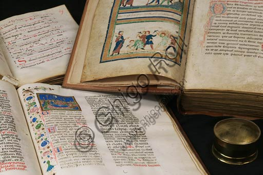 "Modena, Duomo, Archivio Capitolare: a few illuminated manuscripts representing the Capitular Archive. Among them the ""Relatio de innovatione ecclesiae sancti Geminiani"", early XII century, cod. II.1, where it can be seen Architect Lanfranco, directing the workers in the construction of the Modena Cathedral."