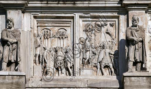 """Rome, Roman Forum, Arch of Constantinus:  Details of Marcus Aurelius reliefs (2nd Century AD.) .On the left panel  """"Rex Datus"""", (a captured enemy chieftain led before the emperor), in the right panel """"Captivi"""", (a similar scene with prisoners)."""