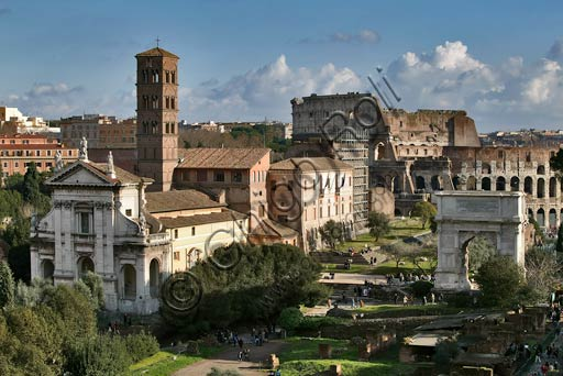 Rome, view over the Roman Forum.On the left the Church of Santa Francesca Romana.On the right the Arch of Titus.Background: the Coliseum.