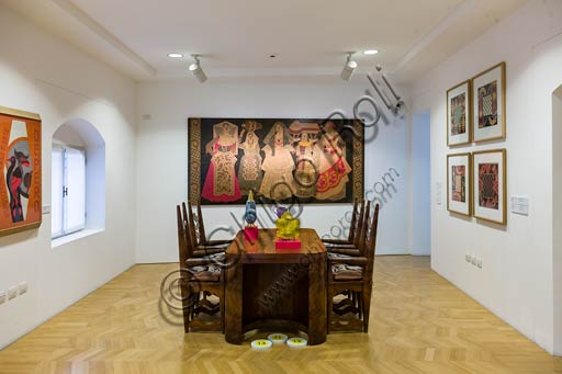 Rovereto, Casa Depero: room at the second floor with furniture and intarsia works by Fortunato Depero. On the table, works of contemporary art by Alessandro Mendini.