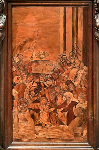 """Genova, Duomo (Cattedrale di S. Lorenzo), interno,  presbiterio, abside, coro, lato sud: """"Salita al Calvario"""", tarsia lignea di Gian Michele De' Pantaleoni (secolo XVI)."""