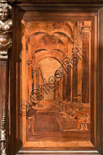 """Genova, Duomo (Cattedrale di S. Lorenzo), interno, abside, coro, lato nord: """"Salomè con la testa del Battista"""", tarsia lignea di Giovanni Francesco Zambelli (secolo XVI)."""