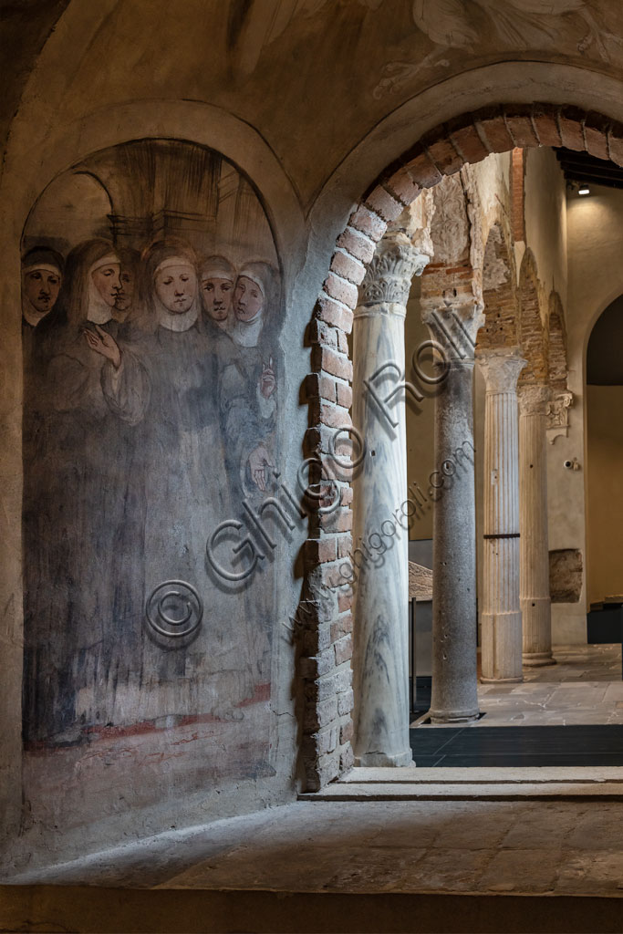 """Brescia, """"Santa Giulia, Museum of the City"""" (Unesco site since 2011): interior of the Chruch of San Salvatore. At the entrance, on the right handside, there is the chapel built at the base of the bell tower, covered by the cycle of frescoes regarding  the Stories of St. Obizio, painted by Romanino between 1526 and 1527."""