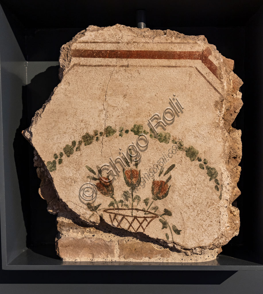"""Brescia, """"Santa Giulia, Museum of the City"""" (Unesco site since 2011), Roman domus of St. Giulia: detail of a frescoed wall representing a basket of red roses (II century AD)."""