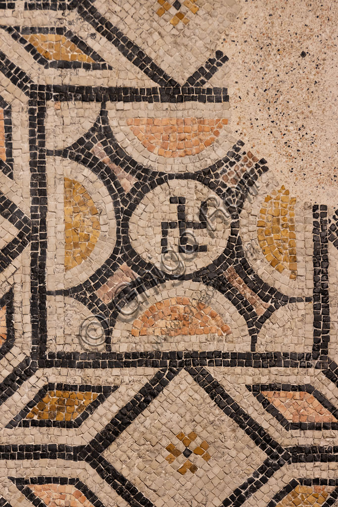 """Brescia, """"Santa Giulia, Museum of the City"""" (Unesco site since 2011): detail of the mosaic floor with a geometric pattern and a hooked cross (II - III century AD)."""