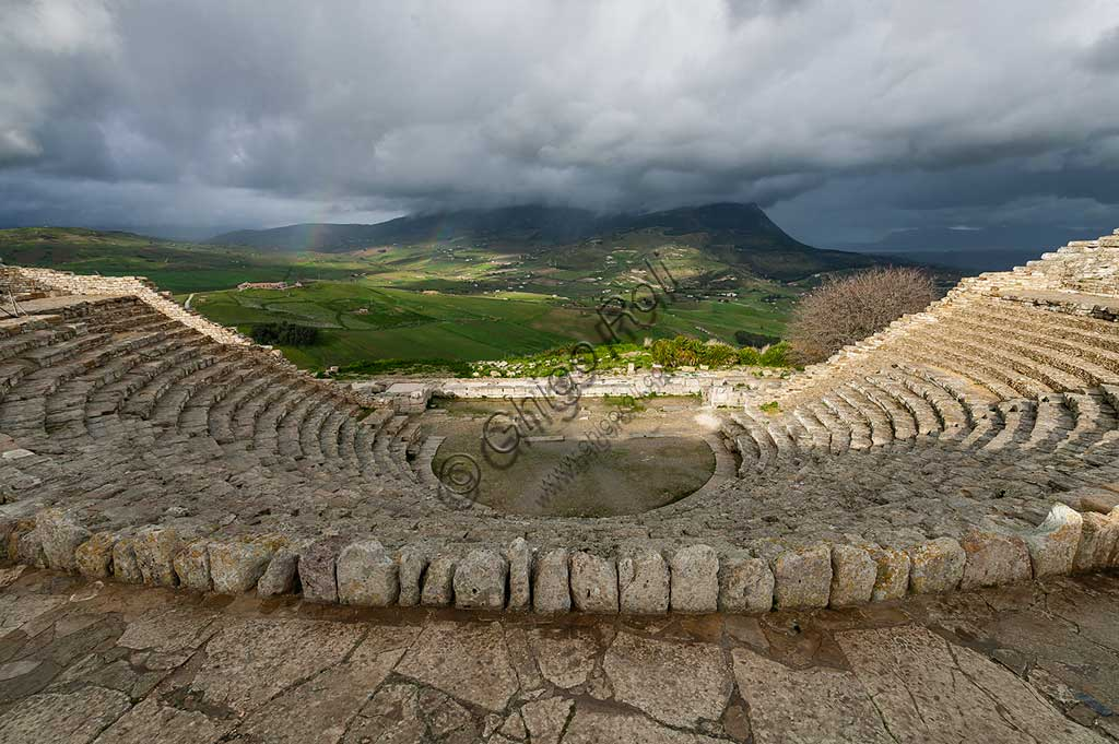 Segesta, Segesta Archaeological Park: the Greek theatre dug into the side of the hill and overlooking Mount Inci.