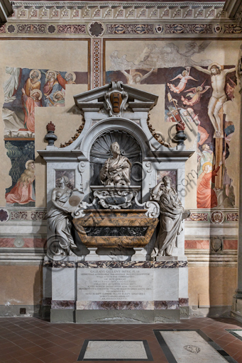 "Basilica of the Holy Cross, left aisle: ""Sepulchre of Galielo Galilei"", 1734-7.It is decorated with a bust by Giovan Battista Foggini (16779 and by the personifications of Astronomy by Vincenzo Foggini and Geometry by Girolamo Ticciati. The surrounding frescoes are remains of the 14th century decoration of the nave, attributed to Mariotto di Nardo."