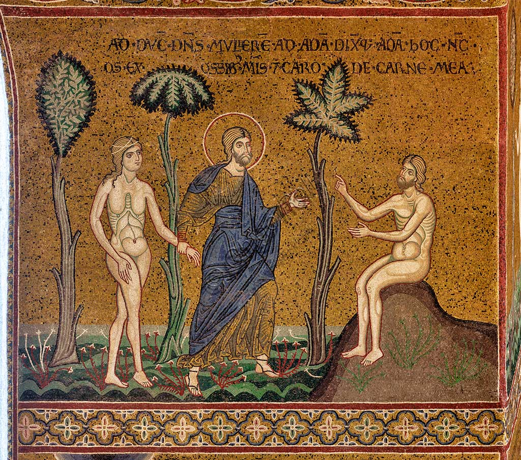 "Monreale, Duomo: ""God introduces Eve to Adam"", byzantine mosaic, XII - XIII sec, on the counterfacade.Latin inscription: ""ADDUCIT DOMINUS MULIEREM AD ADAM DIXITQUE ADAM HOC ENIM OS EX OSSIBUS MEIS ET CARO DE CARNE MEA""."