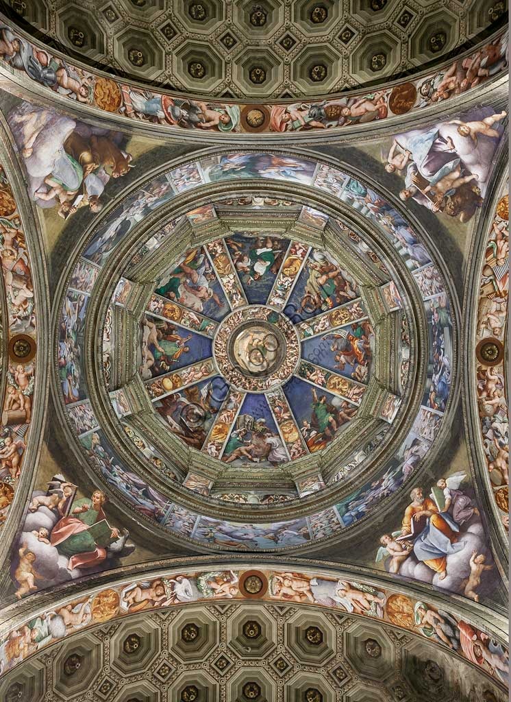 "Piacenza, Sanctuary of the Madonna della Campagna: the dome of the transept. The lantern (the skylight) with God the Father, the segments of the cap with the prophets, the frieze with mythological scenes are frescoes by Giovanni Antonio de Sacchis, known as il Pordenone  (1530 -1532). The eight panels of the tambour with stories of the Virgin, and the pendentives with the Evangelists, are frescoes by Bernardino Gatti, known as ""the Sojaro"" and helpers, 1543."