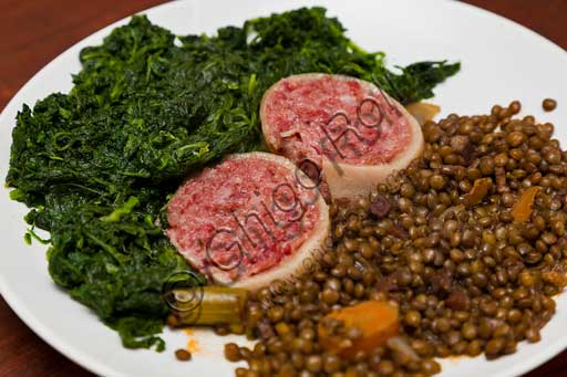 Typical Modena product: zampone (cold cut) served with spinach and lentils.