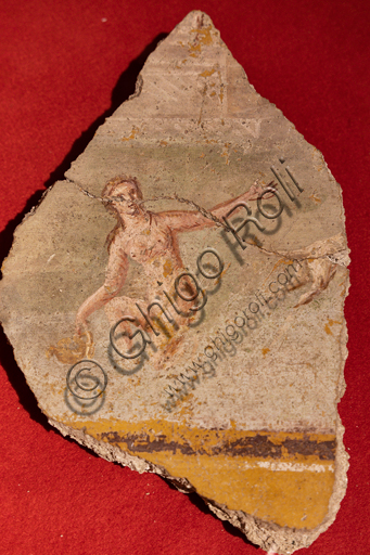 Spoleto, the Roman house: piece of plaster where a female figure is represented, Imperial Age.