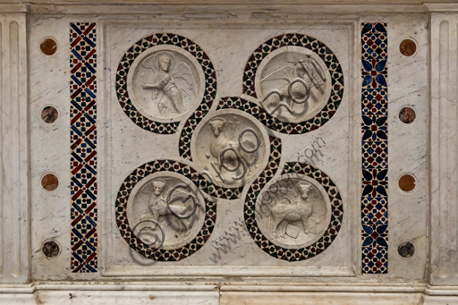 Spoleto, St. Euphemia Church: precious 12th century altar marble frontal, characterised by the Agnus Dei and the symbols of the Evangelists and decoration with Cosmatesque mosaics.