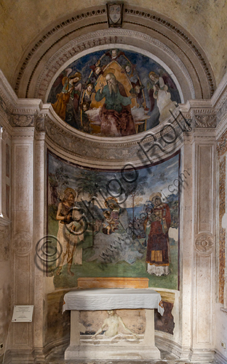 """Spoleto, the Duomo (Cathedral of S. Maria Assunta), right nave, Eroli Chapel (1497): in the apsidiole """"God Father and angels, Madonna with Infant Jesus, the Baptist and S. Stephen"""", and on the frontal """"Lamentation"""", frescoes by Pinturicchio (Bernardino di Betto)."""