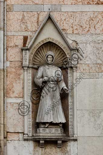 Ferrara, the Cathedral dedicated to St. George, façade: detail with statue of Alberto V d'Este dressed as a pilgrim.