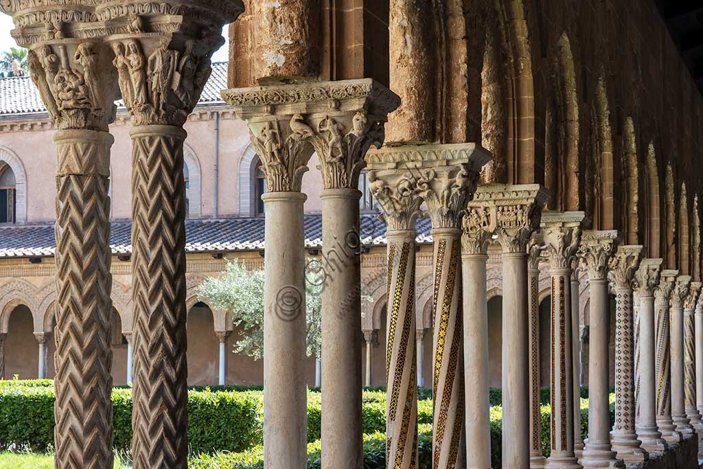"Monreale, Duomo, the cloister of the Benedectine monastery (XII century): a series of capitals and arches on the Northern side of the cloister. In the foreground, the Northern-Western side of capital N24 (""The Massacre of Innocents"")."
