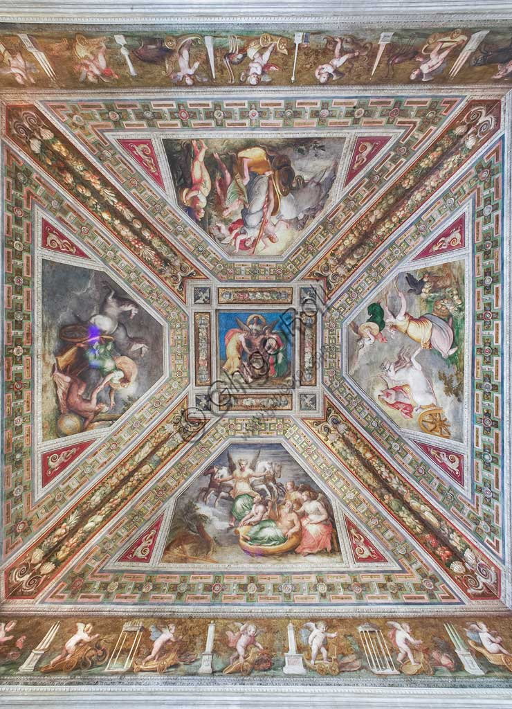 "Ferrara, the Castello Estense (the Estense Castle), also known as Castle of St. Michael: view of the ceiling of the Aurora hall: at the centre ""Time (Cronus)"", aroundframes  with Dawn, Day, Sunset and Night. Work by Bastianino and Ludovico Settevecchi. The cornices which are decorated with putti are by Leonardo da Brescia. The Chamber, former Ercole II's private room, was known in 1600 as the mirror chamber. It gives the name to the  whole representation apartment that Alfonso II wanted. The vault scenes are thought to be the allegory of human life."