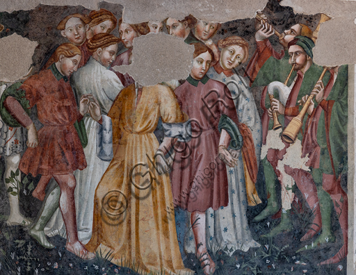 """Spoleto, Rocca Albornoz (Stronghold), Camera Pinta (Painted Room): detail of the frescoes realized between 1392 and 1416, representing courtly and chivalrous subject, made by local painters (with reference to the group connected to the Master of the Dormitio of Terni) or of Padanian origin. The paintings are based on the poem """"Teseida"""" by Boccaccio.Scene of dance with musician."""