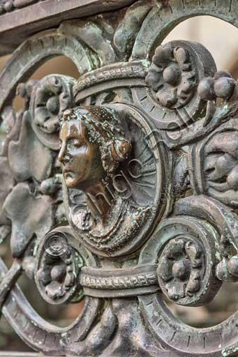 Bergamo, Città alta, Cappella Colleoni (Colleoni Chapel), iron wrought gate realised by Vincenzo Muzio in 1912, according to a drawing by Gaetano Moretti: detail with a woman's head.