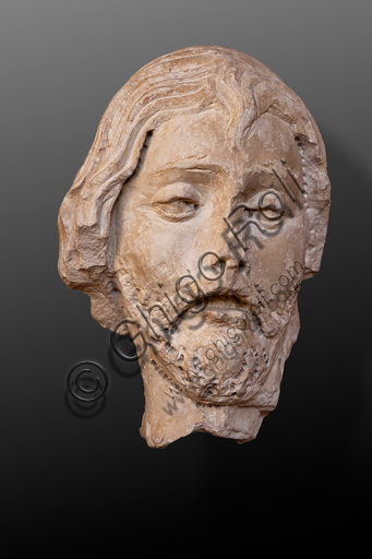 Perugia, National Gallery of Umbria: relief that Agostino di Duccio made for the Façade of the Church of the Maestà delle Volte, around 1475. Detail of a man's head.