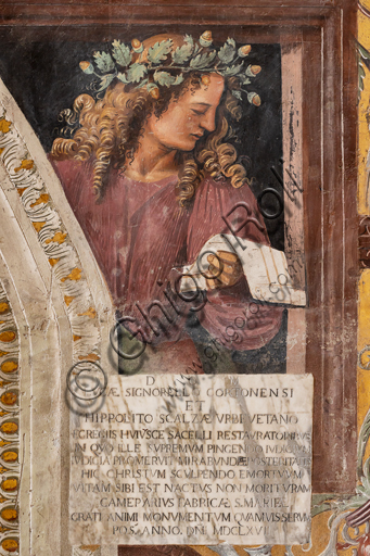 """Orvieto,  Basilica Cathedral of Santa Maria Assunta (or Duomo), the interior, Chapel Nova or St. Brizio Chapel, the lower part of the walls, series of illustrious men where each figure is surrounded by monochrome rounds whose function is to identify the character through the representation of episodes from his works: """"Tibullus""""."""