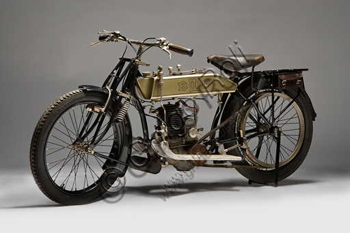 Vintage BMP Type Sport motorcycle.Brand: Soc. Brevetti Malasagna Pinerolomodel: Sport typecountry: Italy - Turinyear: 1921conditions: restoreddisplacement: 239 cc. (bore and stroke 66 x 70)engine: single-cylinder two-stroke gearbox: four ratios split between a gearbox and a reducer with coaxial control on the tank and final belt transmissionEmilio Malasagna is active in Pinerolo with his brother, starting from 1920. He produces motorcycles from 1920 until '24. Some technical characteristics, as well as the place of production, suggest that this bike, like the others built by BMP and very similar to this one, was designed especially for climbs. Its peculiar characteristics that suggest a particularly heavy use are the large and deep finning of the cylinder, the lubrication system which, in addition to the use of a 10% mixture, also included a pump for the extra drip oil, but above all the particular type of two-speed