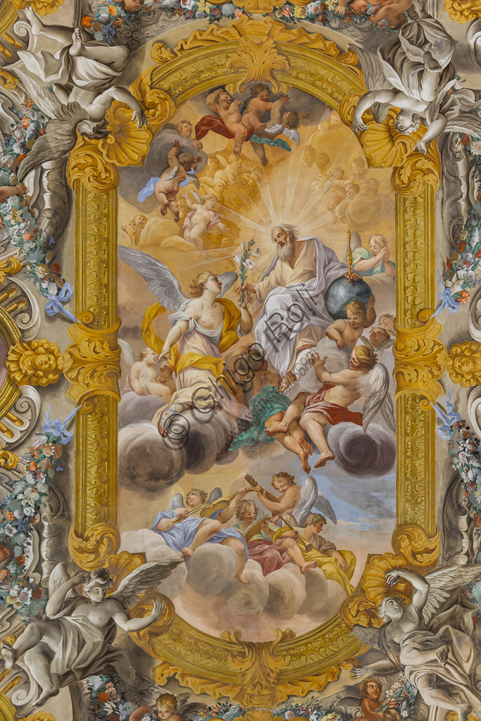Todi, the Church of Nunziatina: the decoration of the ceiling that recalls the great Roman churches of the Baroque period, with angels, flowers and fruit among which eight medallions stand out, surrounding the main fresco, depicting episodes from the life of the Virgin.