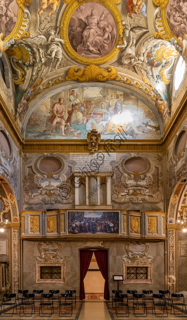 """Todi, the Church of Nunziatina: the counter-façade with a painting on panel inspired by the """"The Wedding at Cana"""" * by Veronese above which  there is a fresco representing """"The Madonna of the milk""""."""
