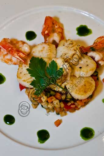 "Verona, ""Tre Corone, Giovanni Rana's restaurant"": a plate of scallops and prawns."