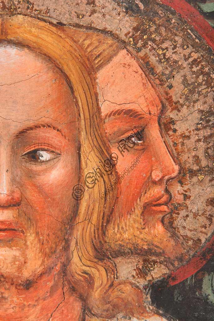 """Rocca di Vignola, Cappella Contrari, parete orientale: """"Trinità trifronte e Albero della Vita"""". Affresco del Maestro di Vignola, anni Venti del Quattrocento. Particolare di due dei volti."""