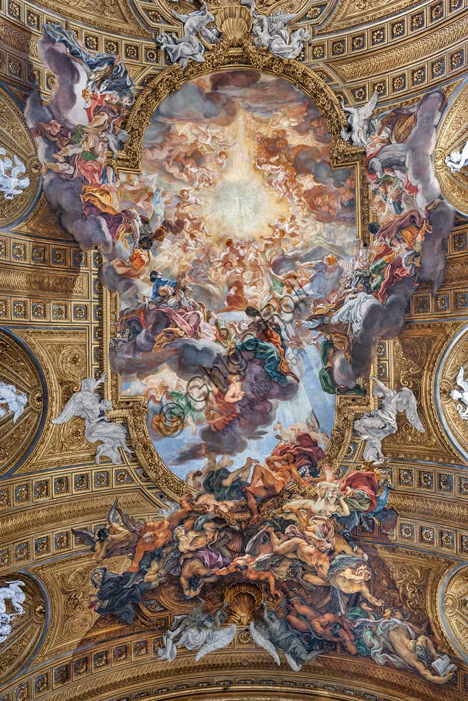 """Church of Jesus, the interior: view of the vault of the nave with """"The Triumph in the Name of Jesus"""", fresco by Giovan Battista Gaulli known as Baciccia, 1679. The golden cornice and the plasters are by Ercole Antonio Raggi."""