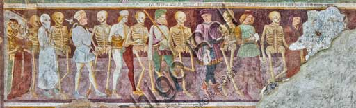 """Clusone, Oratory of Disciplini or St. Bernardino, façade: frescoes with the Triumph of Death on the top and a Dance of Death (Macabre Dance) in the lower register (1485). All the frescoes are by Giacomo Borlone De Buschis.Detail of the """"Dance of Death"""" with the meeting between three dead and three living people."""