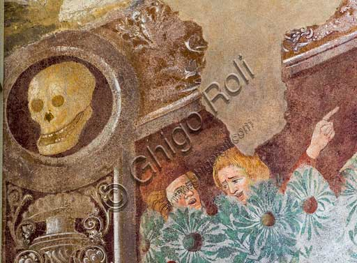 Clusone, Oratory of Disciplini or St. Bernardino, façade: frescoes with the Triumph of Death on the top and a Dance of Death (Macabre Dance) in the lower register (1485). All the frescoes are by Giacomo Borlone De Buschis.Detail of the Triumph of Death standing on a sarcophagus where the dead Pope and the Emperor lie. Theay are surrounded by serpents, scorpions and toads (symbols of pride and sudden death). Death hold big scrolls to remind everyone that Life is not everlasting.