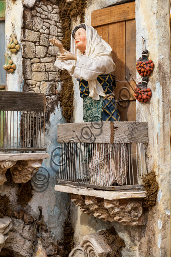 Assisi, Sicilian Nativity scene by Ivano Vecchio: detail with a small statue of a woman on a balcony.