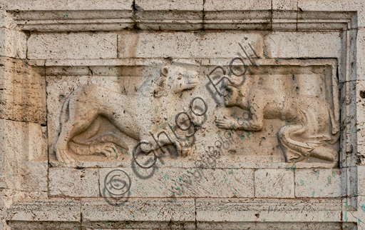 """Spoleto, St. Peter's Church, the façade ( It is characterized by Romanesque reliefs (XII century), detail of one of the five bas-reliefs to the left of the main portal: """"Man begging a lion """"."""