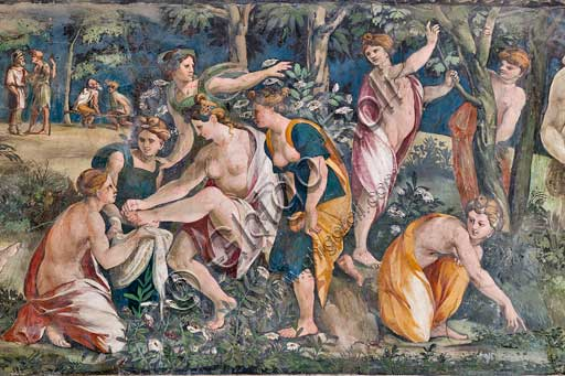 Rome, Villa Farnesina, The Hall of Perspectives: the ample frieze with mythological scenes inspired by the Ovid  Metamorphoses.  Detail with Venus and  Adonis. She is removing a thorn from her foot while Adonis is lying dead, killed by a wild boar. Frescoes by Baldassarre Peruzzi (1517-8).