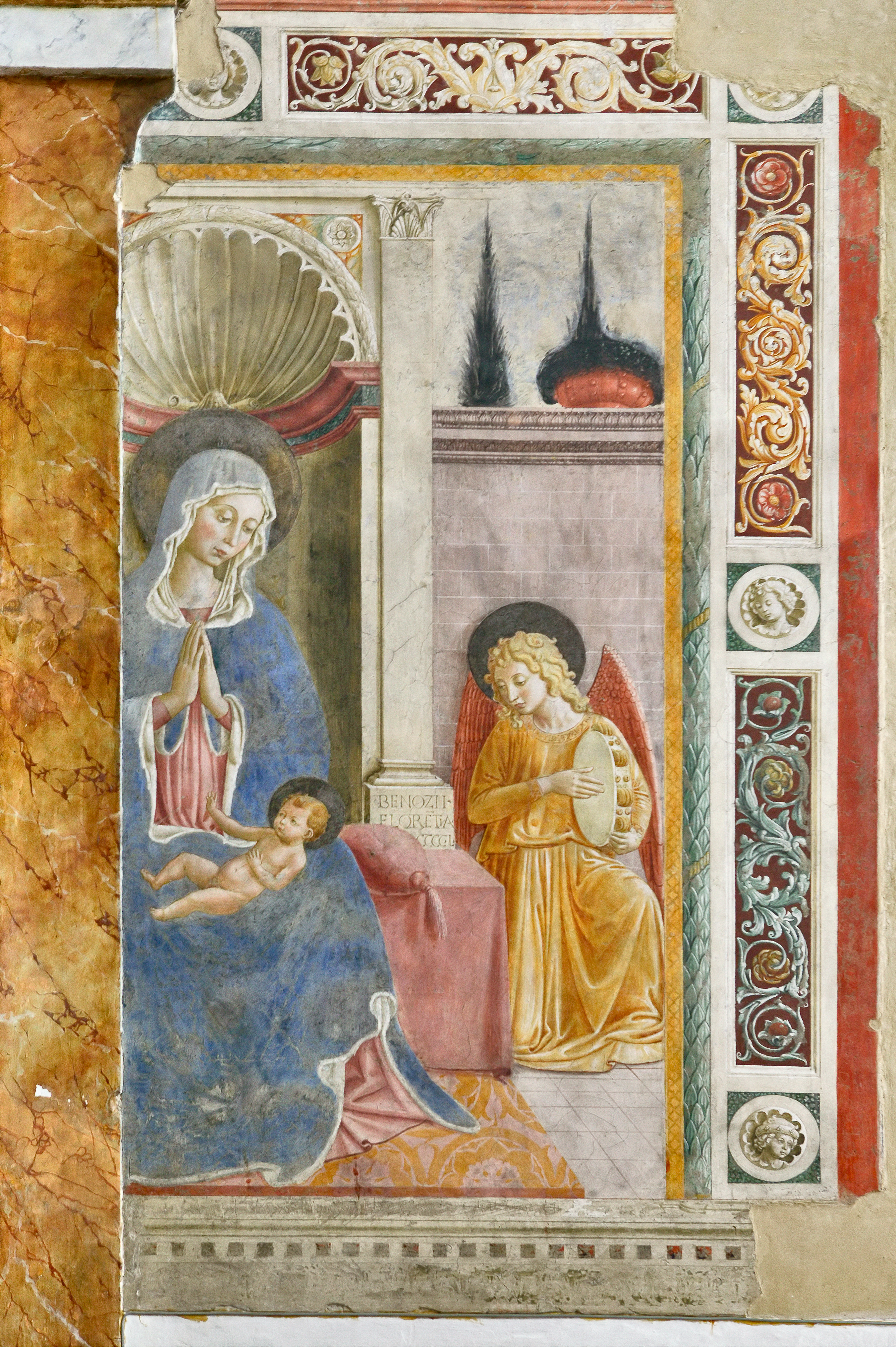 "Montefalco, Church of San Fortunato, altar on the right: ""Virgin adoring the Child and Angel playing Music"", fresco by Benozzo Gozzoli."