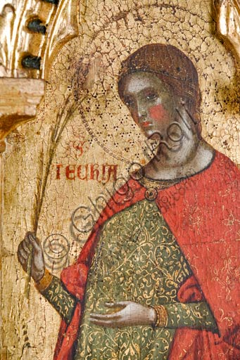 Croatia, Rab (Arbe), Museum of the Cathedral: Paolo Veneziano, Polyptych of the Crucifixion (1350-55). Detail with St. Thecla.