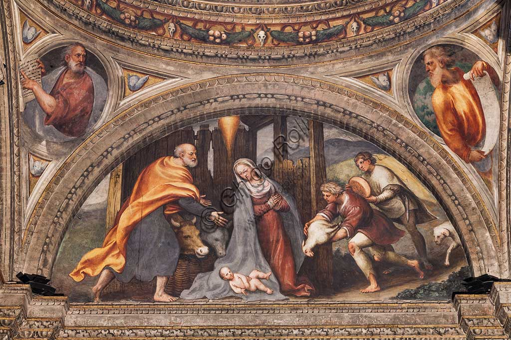"Piacenza, Sanctuary of the Madonna della Campagna, left aisle, first chapel, lunette: ""Adoration of the Shepherds"". Frescoes by Giovanni Antonio de Sacchis, known as il Pordenone, 1530 - 1532."