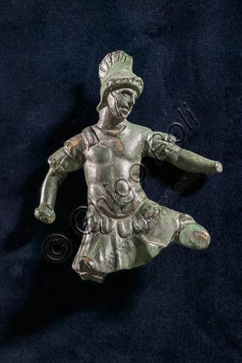 Modena, Museo Civico Archeologico Etnologico: Applique in bronzo raffigurante soldato in combattimento. Fossalta, Modena. I secolo d.C.(?). Arte romana.