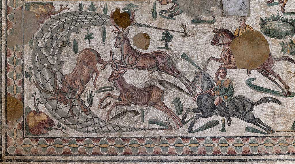 Piazza Armerina, Roman Villa of Casale, which was probably an imperial urban palace. Today it is a UNESCO World Heritage Site. Detail of the floor mosaic in the corridor of the Grat Hunt. Detail with  the capture of deer.In spite of the name with which it is known (The Great Hunt), the subject of the floor mosaic represents a great capture. It does not represent  hunting.Wild beasts are captured for the games in the amphitheatres of the Roman Empire: no animal is in fact shot down and hunters use only weapons to defend themselves.
