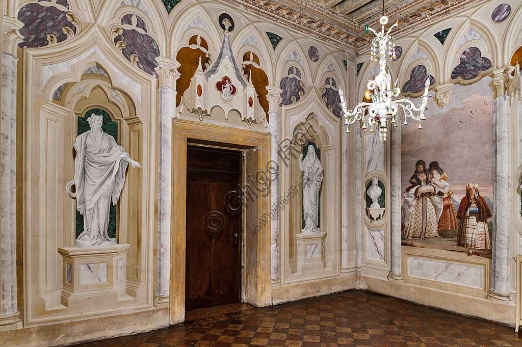 """VIicenza, Villa Valmarana ai Nani, Foresteria: veduta della Stanza delle finte architetture gotiche. Sulla destra:  """"Passeggiata invernale"""", affresco di Giandomenico Tiepolo, 1757."""